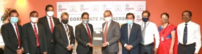 People's Bank and Toyota Lanka (Pvt) Limited exchanging the MOU