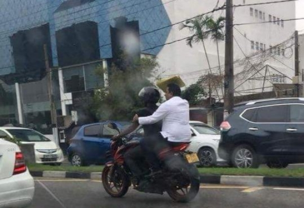 Education Minister Seen Flouting Traffic Laws During Cheap PR Stunt: Rides On Pillion Of Bike To Avoid Severe Traffic
