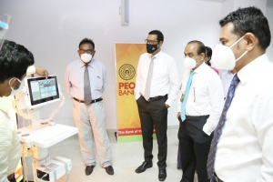 People's Bank commemorates 60th anniversary by donating portable Ultrasound scanner to National Hospital