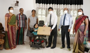People's Bank presents laptop to top-performing differently-abled student for her outstanding O/L results